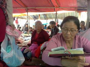 Woman in Nepal Reading Bible